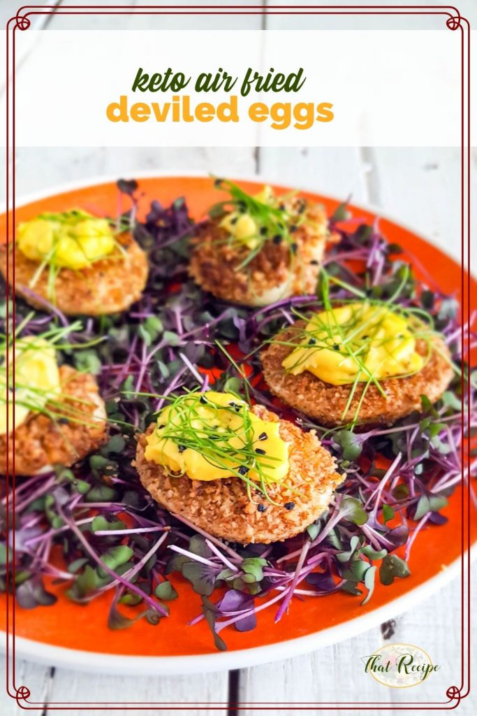 "fried deviled eggs on bed of microgreens with text overlay ""keto air fried deviled eggs"""
