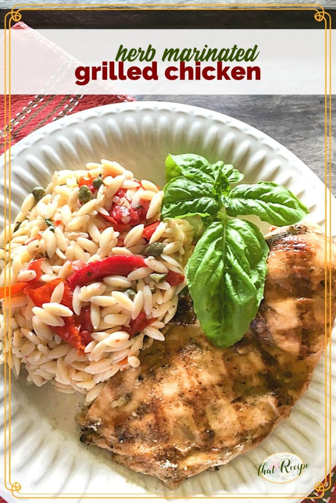 "grilled chicken on a plate with orzo pasta salad and text overlay ""herb marinated grilled chicken"""