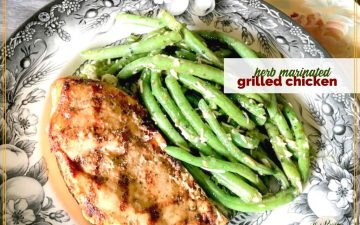 "grilled chicken on a plate with green beans and text overlay ""herb marinated grilled chicken"""