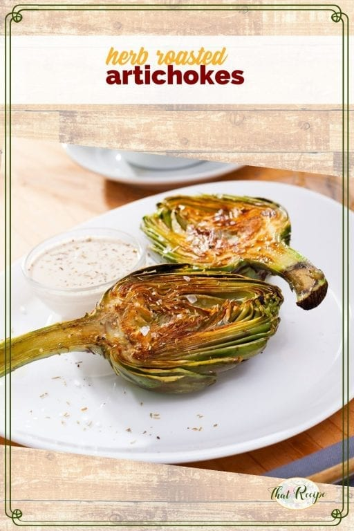 "artichoke halves on a plate with dipping sauce ad text overlay ""herb roasted artichokes"""