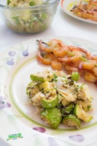 grilled summer squash and quinoa on a plate with shrimp skewers