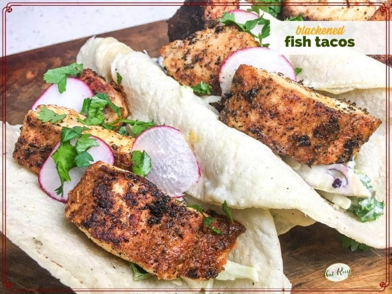 "fish tacos with sauce and radish slices with text overlay ""blackened fish tacos"""