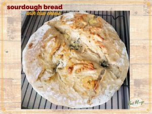 """loaf of artisan bread with text overlay """"sourdough bread with blue cheese"""""""