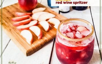 "glass of red wine spritzer with peach slices on a cutting board ""citrus peach red wine spritzer"""