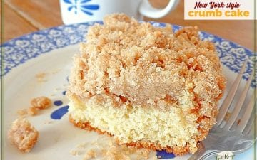 "slice of coffee cake on plate with coffee mug in background and text overlay ""New York style crumb cake"""