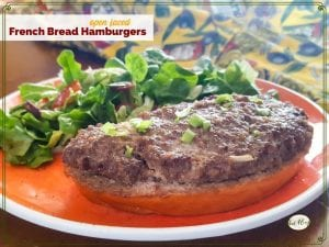 """open faced burger on a plate with a green salad and text overlay """"Open Faced French Bread Hamburger"""""""