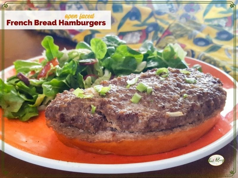 "open faced burger on a plate with a green salad and text overlay ""Open Faced French Bread Hamburger"""