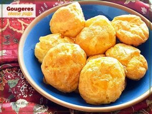 """plate of cheese puffs with text overlay """"Gougeres cheese puffs"""""""