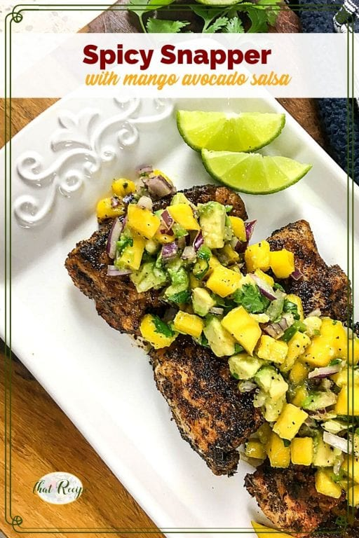 "cajun snapper on a serving plate topped with mango salsa and text overlay ""spicy snapper with mango avocado salsa"""