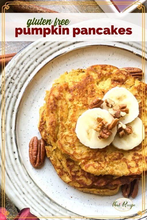 "top down view of pancakes on a plate topped with pecans and banana slices and text overlay ""gluten free pumpkin pancakes"""