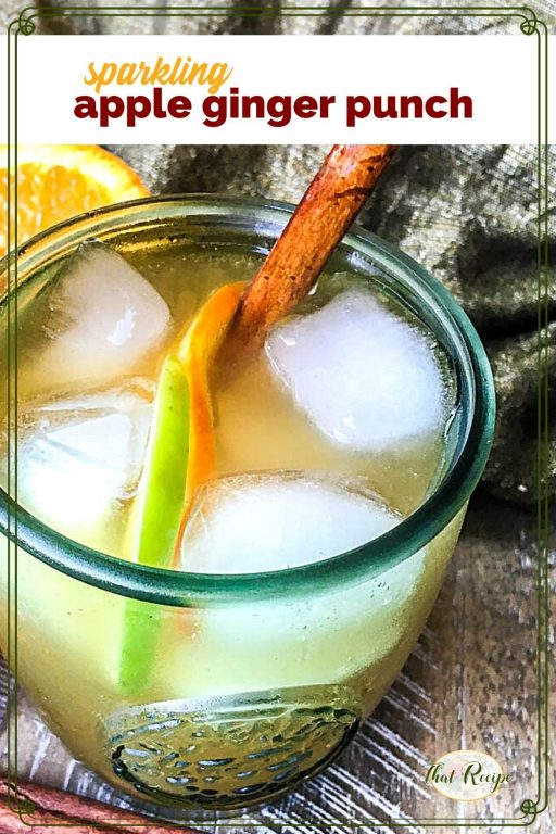 """close up view of punch in a glass with text overlay """"sparkling apple ginger punch"""""""