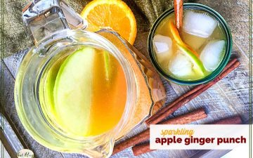"top down view of pitcher and glass filled with punch and text overlay ""sparkling apple ginger punch"""
