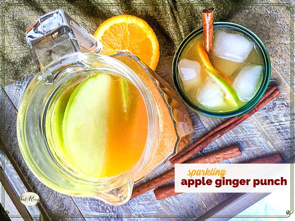 """top down view of pitcher and glass filled with punch and text overlay """"sparkling apple ginger punch"""""""