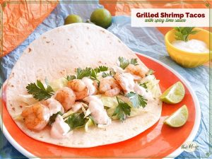 "shrimp tacos on a bright background with text overlay ""Grilled Shrimp Tacos with spicy lime sauce"""