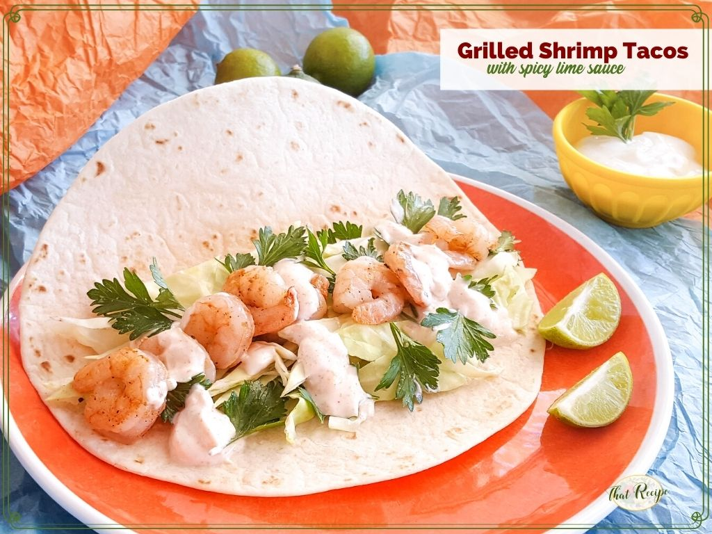 """shrimp tacos on a bright background with text overlay """"Grilled Shrimp Tacos with spicy lime sauce"""""""