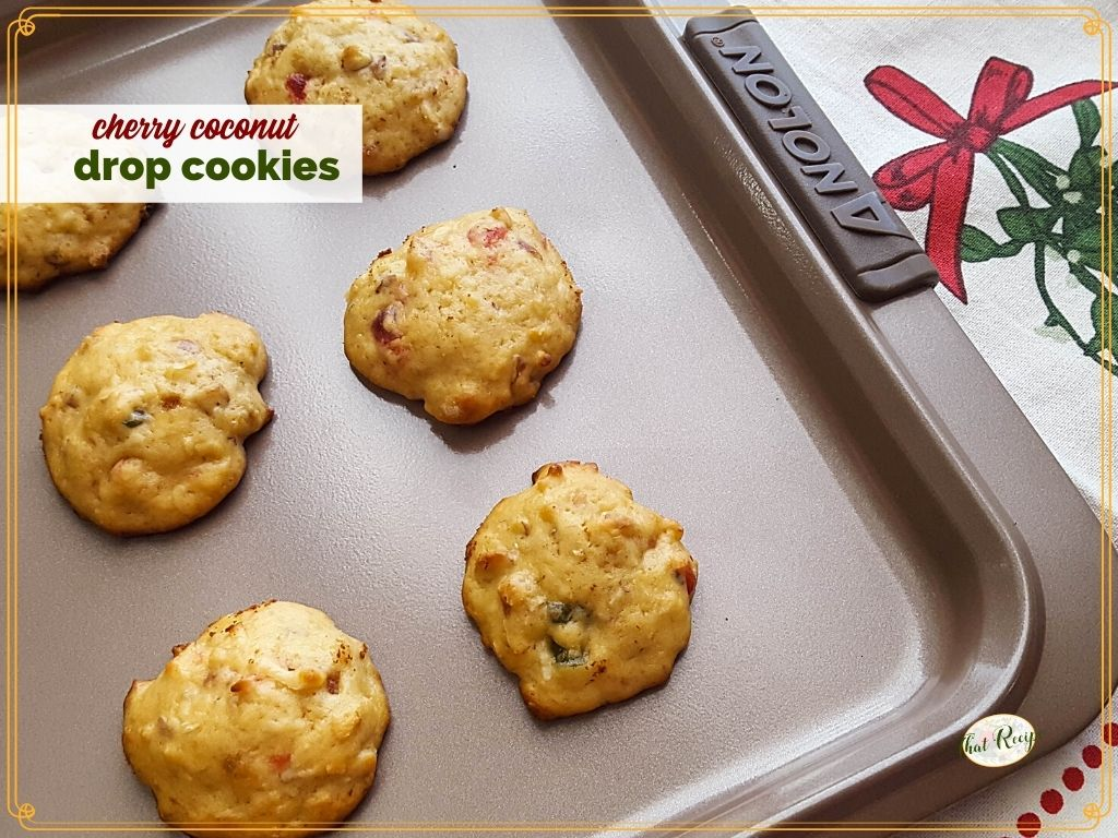 """cookies on a baking pan with text overlay """"cherry coconut drop cookies"""""""