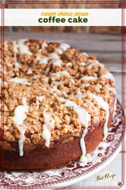 """coffee cake with streusel topping and glaze on a plate with text overlay """"pecan cream cheese coffee cake"""""""
