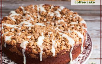 "coffee cake with streusel topping and glaze on a plate with text overlay ""pecan cream cheese coffee cake"""