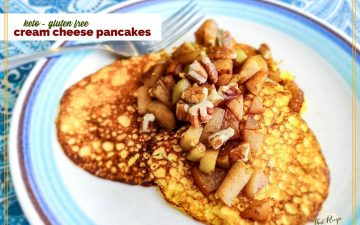 "pancakes on a plate topped with pears and nuts with text overlay ""keto gluten free Cream Cheese Pancakes"""