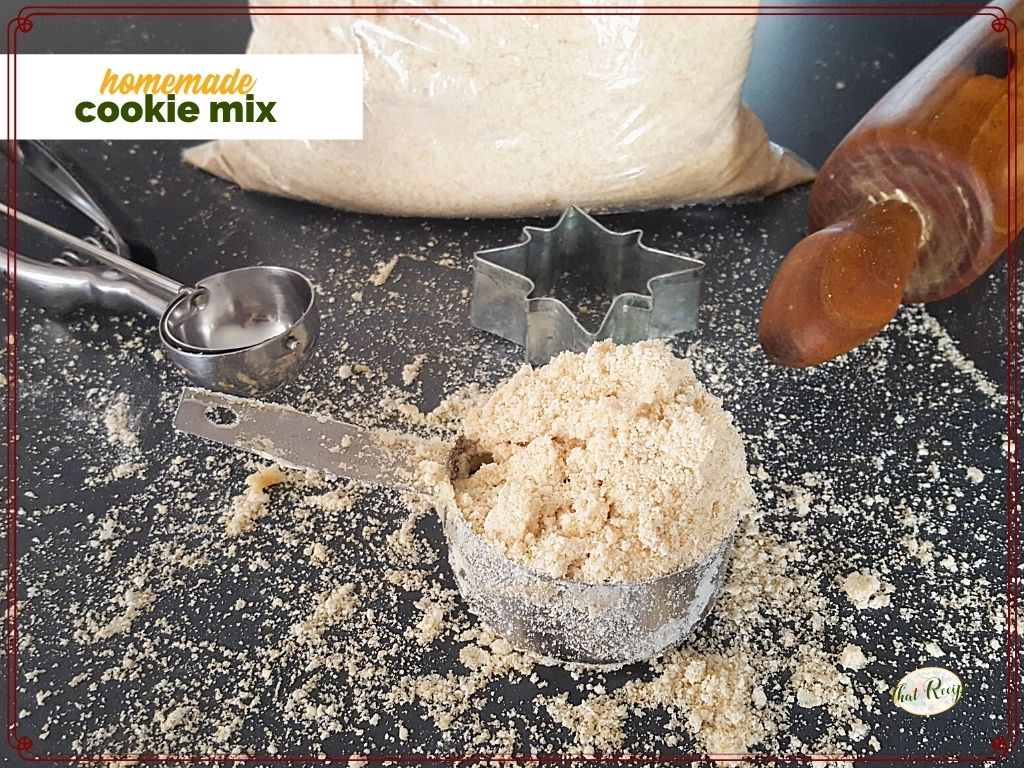 "cup of cookie mix on a counter with cookie scoop and rolling pin and text overlay ""homemade cookie mix"""