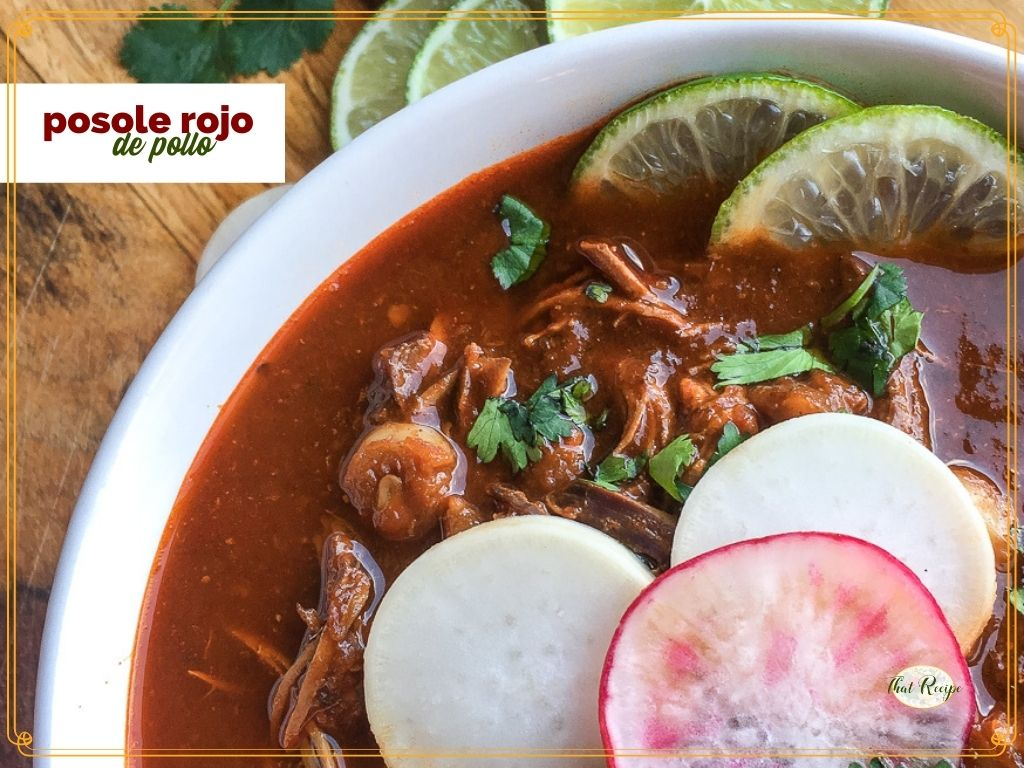 "top down view of red soup topped ith radishes and limes and text overlay ""posole rojo de pollo"""