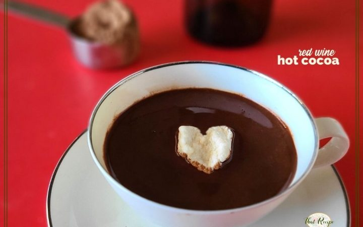 """cup of cocoa with heart shaped marshmallow and text overlay """"red wine hot cocoa"""""""