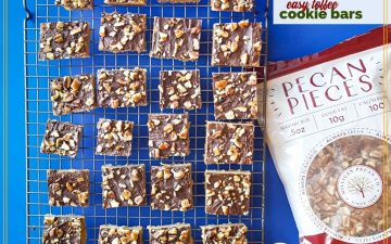 "cookies on a cooling rack with bag of pecans and text overlay ""easy toffee cookie bars"""