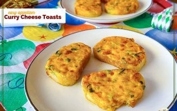"mini cheese appetizers on a plate with text overlay ""Curry Cheese Toasts"""