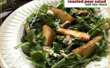 "roasted pears on arugula with text overlay ""roasted Pear Salad with blue cheese"""