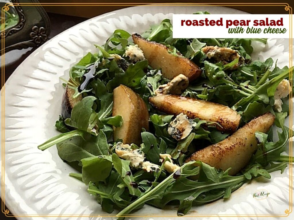 """roasted pears on arugula with text overlay """"roasted Pear Salad with blue cheese"""""""