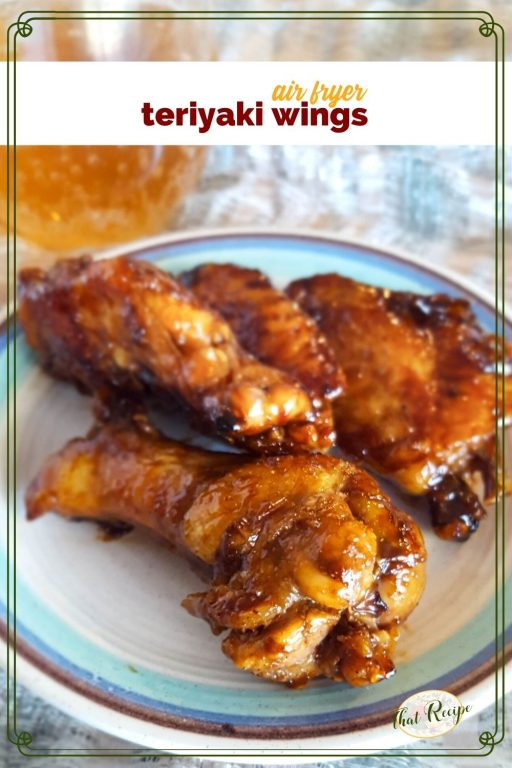 "chicken wings on a plate with text overlay ""air fryer teriyaki wings"""