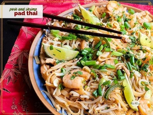 """top down view of boodles with shrimp and text overlay """"pork and shrimp pad thai"""""""