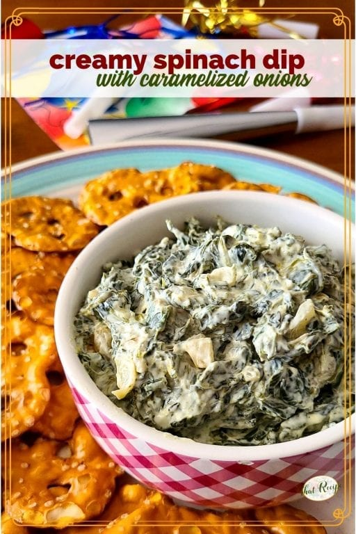 "spinach dip in a bowl with pretzel crackers around it and text overlay ""creamy spinach dip with caramelized onions"""