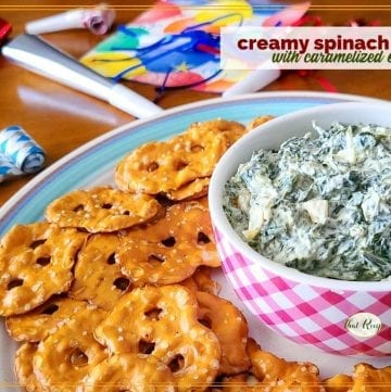 """spinach dip in a bowl with pretzel crackers around it and text overlay """"creamy spinach dip with caramelized onions"""""""
