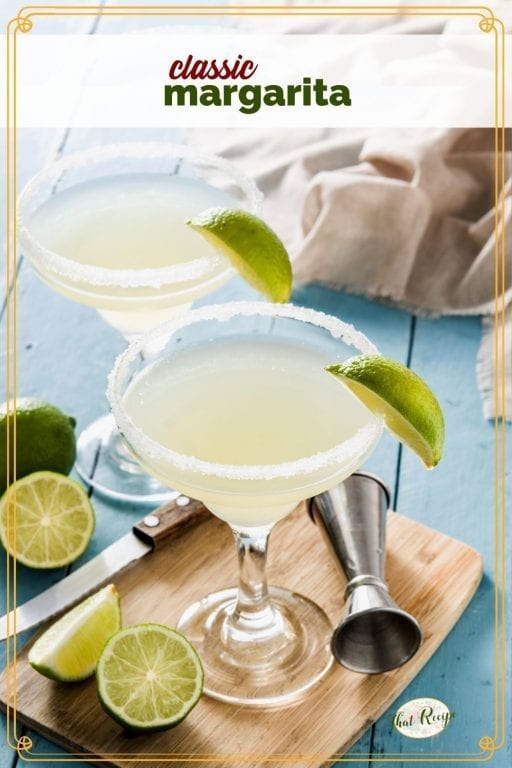 """margarita in a glass surrounded by cut limes with text overlay """"classic margarita"""""""