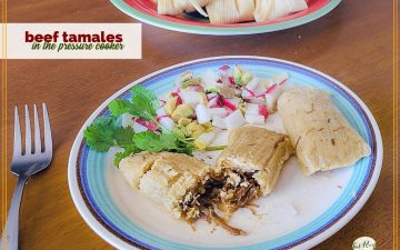 "beef tamales on a plate with text overlay ""beef tamales in the pressure cooker"""