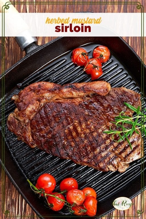 "sirloin steak and tomatoes on a cast iron griddle with text overlay ""herbed mustard sirloin"""