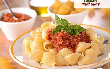 """pasta with meat sauce on a plate with text overlay """"tuscan meat sauce"""""""