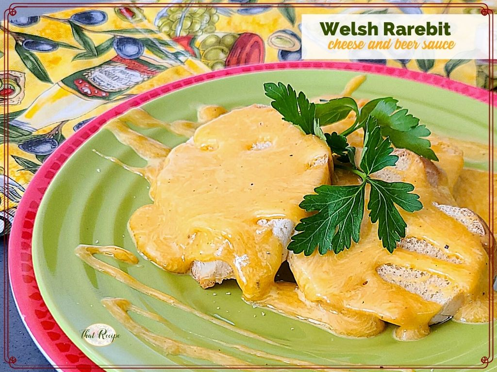 """toast with cheese sauce on a plate and text overlay """"Welsh Rarebit cheese and beer sauce"""""""