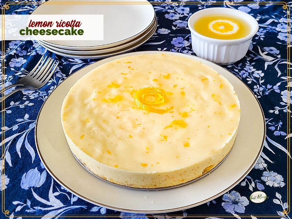 """homemade cheesecake on a plate with text overlay """"lemon ricotta cheesecake"""""""