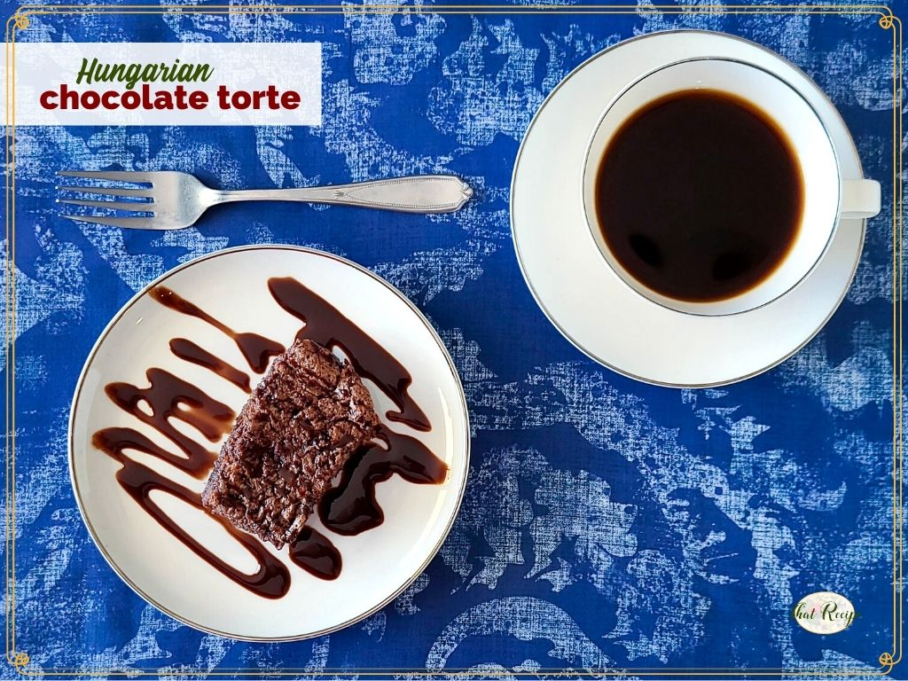 """slice of chocolate torte on a plate drizzled in chocolate sauce with text overlay """"Hungarian chocolate torte"""""""