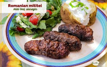 """mini sausages on a plate with salad and potato and text overlay """"Romanian mititei mini beef sausages"""""""