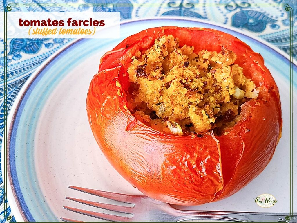 """stuffed tomato on a plate with text overlay """"tomates farcies"""""""
