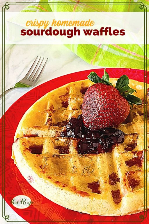 """waffle topped with strawberry and jam and text overlay """"crispy homemade sourdough waffles"""""""