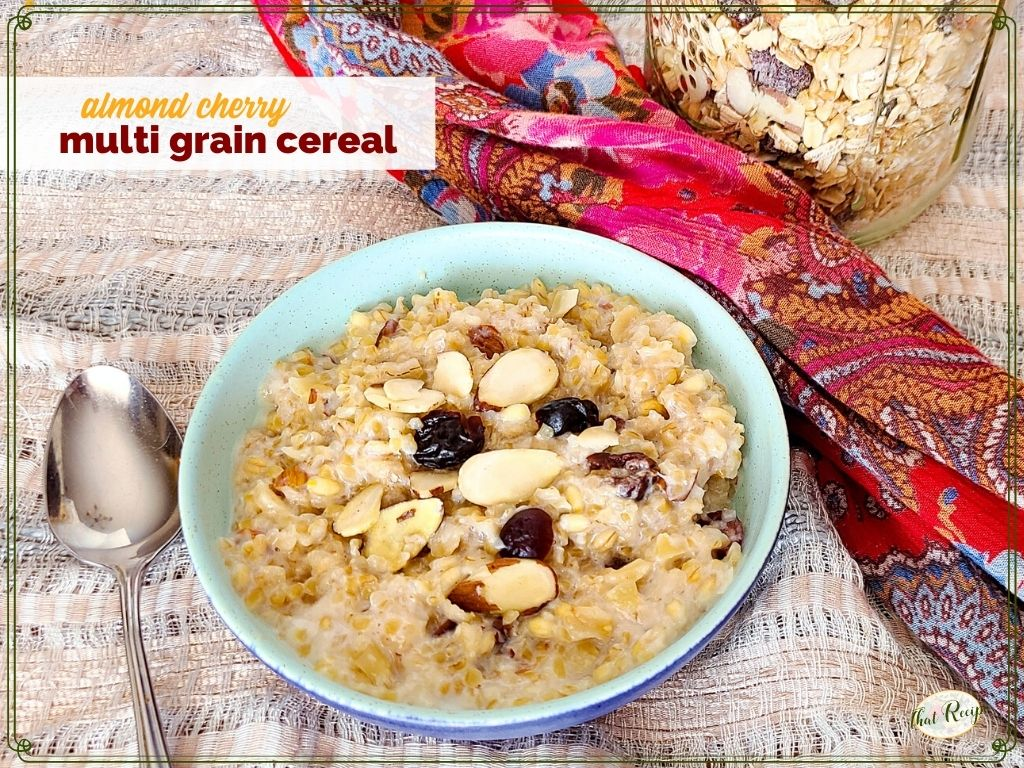 """bowl of hot breakfast cereal with text overlay """"almond cherry multi grain cereal"""""""