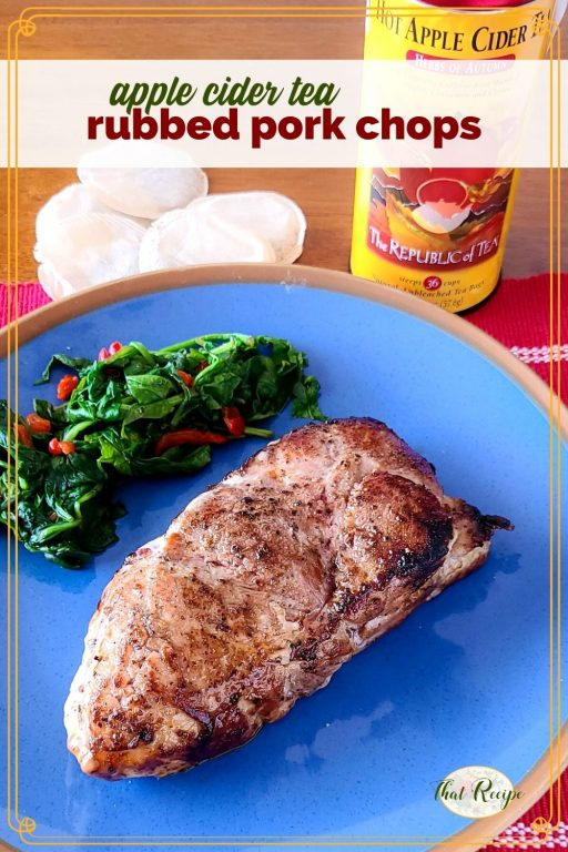 """pork chop on a plate with greens and text overlay """"apple cider tea rubbed pork chops"""""""
